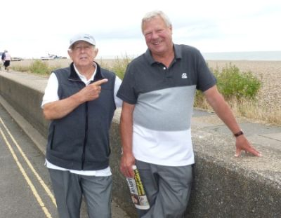 BEACH BOYS: Patrick Miller and John Young take a seafront stroll to work up an appetite for their fish-and-chips lunch.