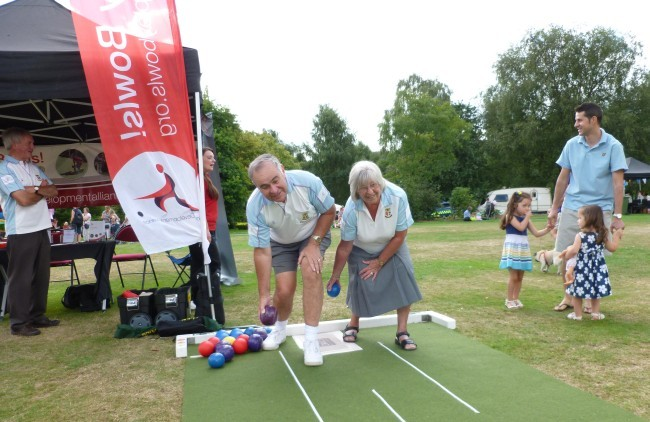 Brentwood Bowling Club captains Richard Rose and Margaret Rayment try their hand at short-mat bowls in the park.