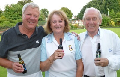 CHEERS!: John Young, left, Kate Davies and Steve Shute with their winning rink prizes.