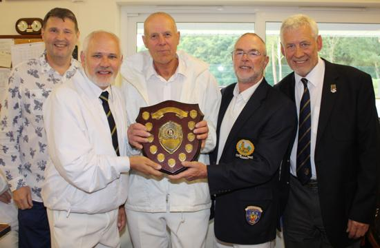 WINNERS: Ingatestone players with Gary Ebsworth, left, and Fred Wasmuth, right.