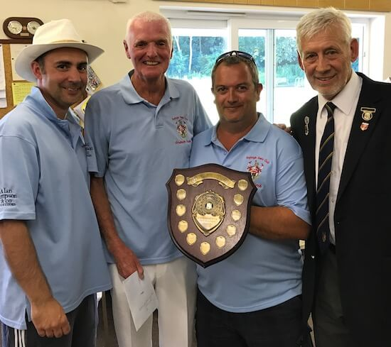 Brentwood Bowling Club men's captain Fred Wasmuth, right, presents the 2017 Invitation Triples winners' shield to the Rayleigh team.