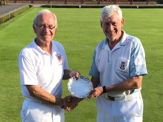 Essex County bowls captain Bob Westley, left, hands the Centenary Plate to Fred Wasmuth.