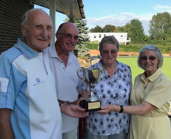 Brian Martin, left, and Ted Vidler receive the Richards Trophy from Janet Alderton and Celia Eade at Brentwood Bowling Club 22nd July 2018